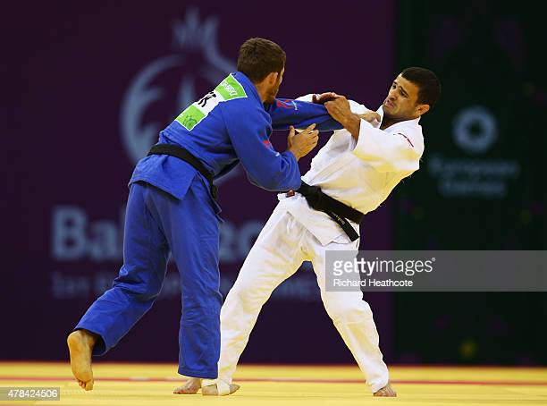 Artiom Arshanski of Israel and Amiran Papinashvili of Georgia compete in the Men's Judo -60kg round of 16 contest during day thirteen of the Baku...