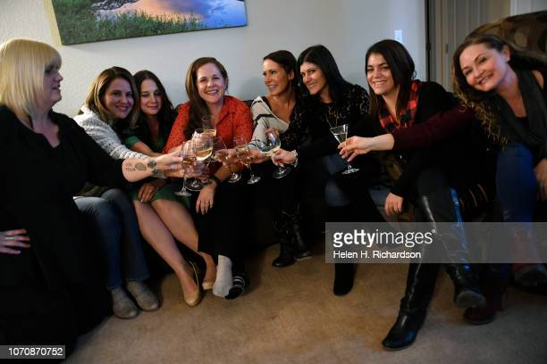 Artis Jacobsen fourth from left and her lifelong and closest friends surround her at her home on December 9 2018 in Arvada Colorado They are from...