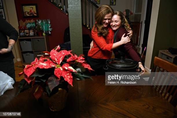 Artis Jacobsen left hugs her close friend Chelse Oakley right during a gathering at her home on December 9 2018 in Arvada Colorado Twenty years ago...