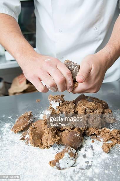Artisan baker kneading ginger bread.