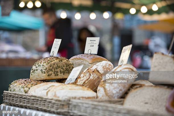 artisan bread at borough market, london - borough market stock pictures, royalty-free photos & images