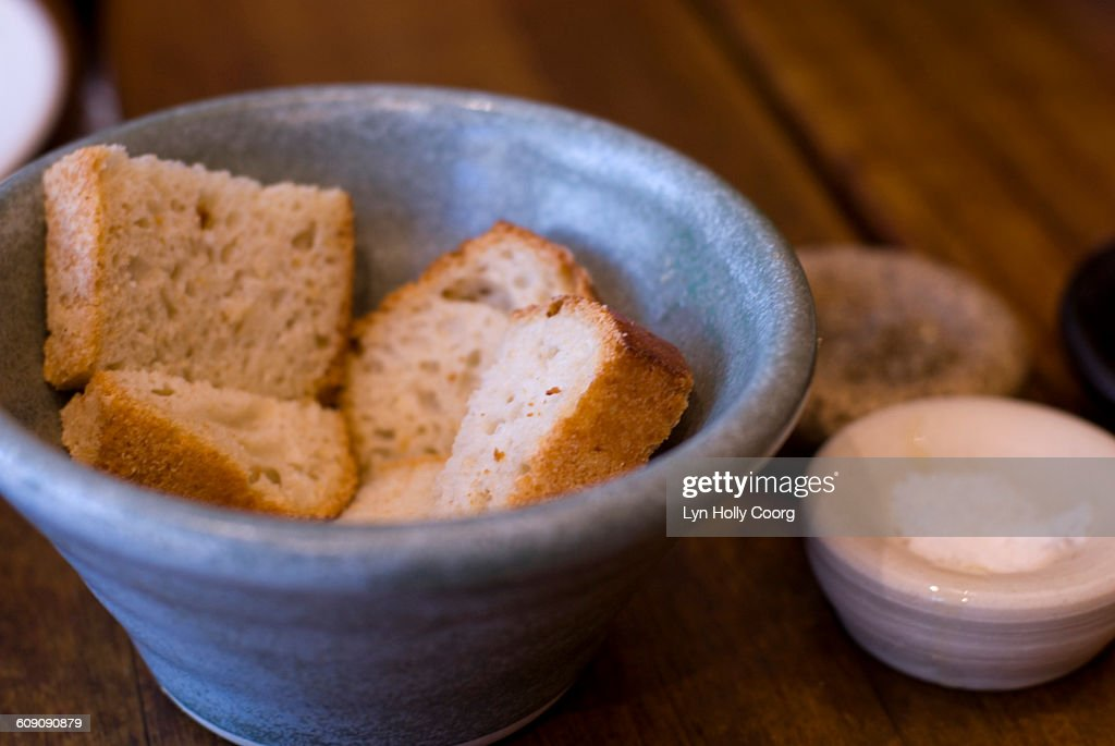 Artisan bread in blue china bowl : Stock Photo