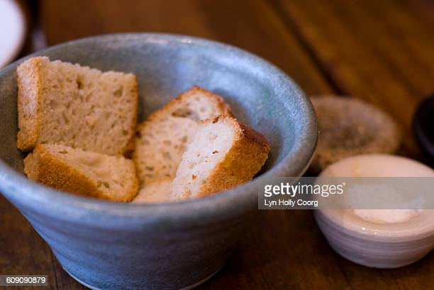 artisan bread in blue china bowl - lyn holly coorg stock photos and pictures