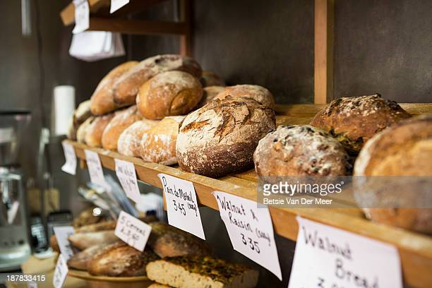 Artisan bread on shelves in bakery.