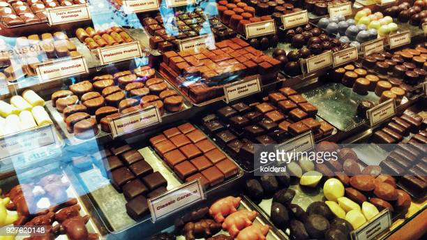 artisan chocolate for sale in boutique - chocolate shop stock pictures, royalty-free photos & images
