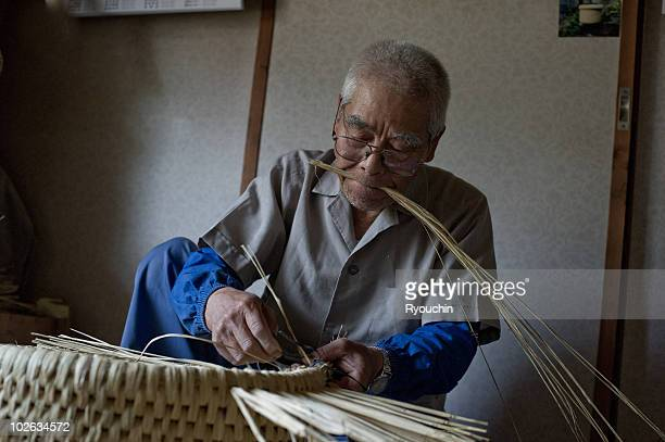 Artisan crafting a Japanese basket