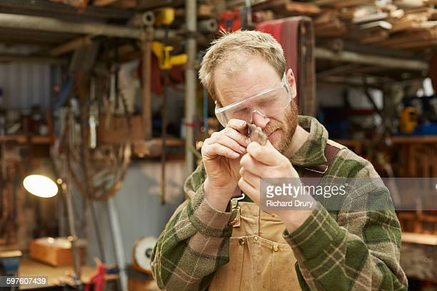 Artisan cutlery maker in his workshop