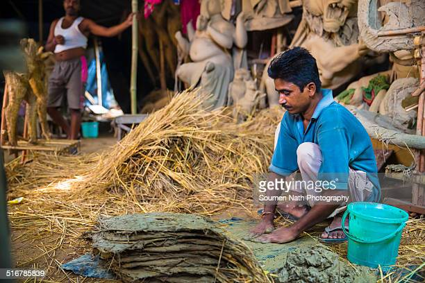 artisan making durga idols - durga stock photos and pictures