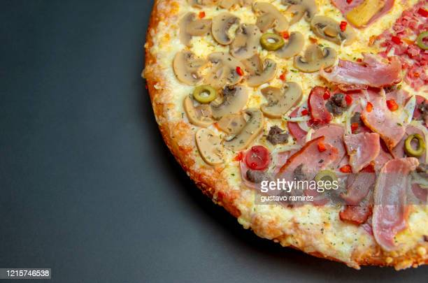 artisan pizza with meat cheese and fruits - hawaiian pizza stock pictures, royalty-free photos & images
