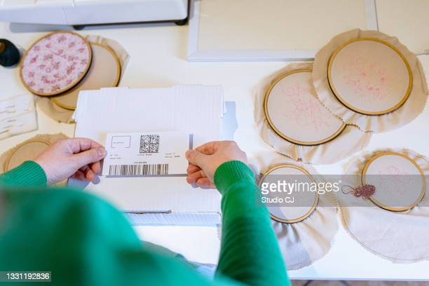 artisan placing bar code on packaging to send artwork - art and craft product stock pictures, royalty-free photos & images