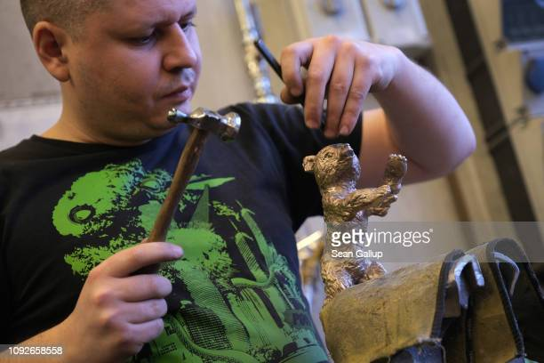 Artisan Timur Hepting works on a Berlinale Film Festival bear trophy at the Hermann Noack Bildgiesserei foundry where the trophies are produced on...