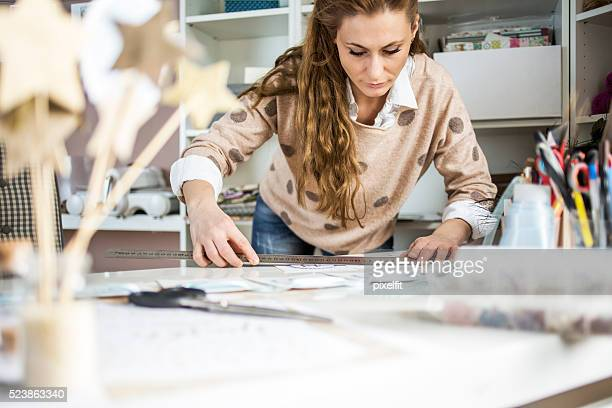 Artisan woman working with paper