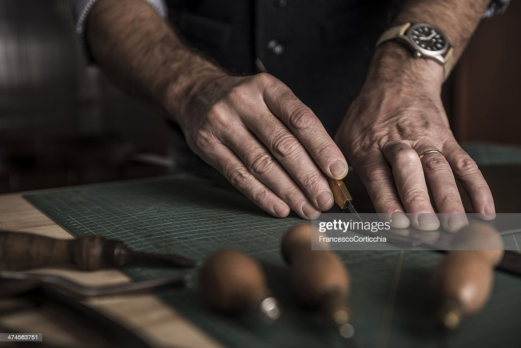 Artisan working with leather : Stock Photo