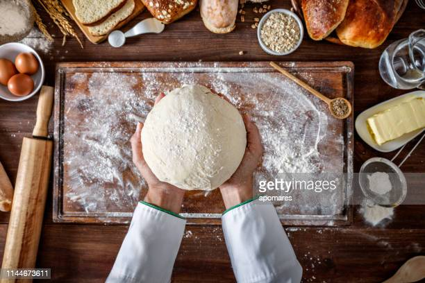 artisanal bakery: artisan chef hands kneading dough - bread stock pictures, royalty-free photos & images