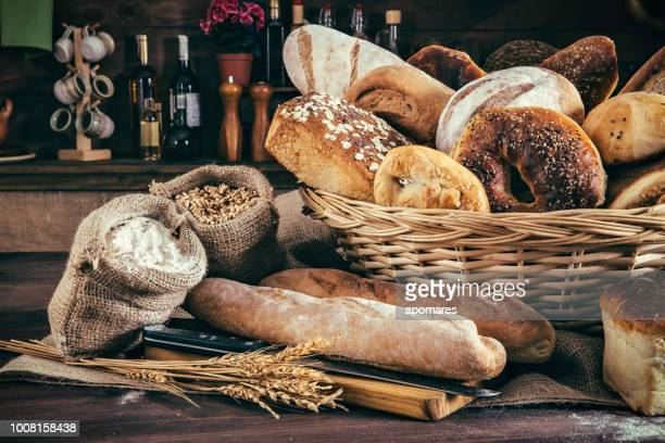 artisanal bakery:  fresh mixed bun, rolls and ingredients - loaf of bread stock pictures, royalty-free photos & images
