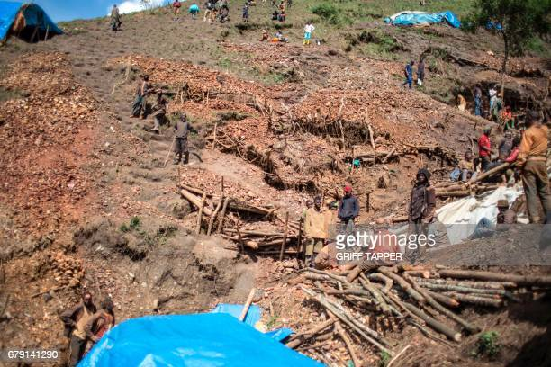 Artisanal miners rest at Kacuba cassiterite mine near Nzibira southwest of Bukavu in Democratic Republic of Congo on March 29 2017 In the lush hills...