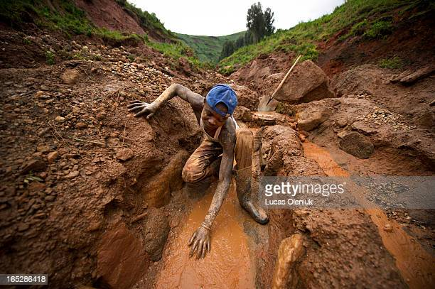 Artisanal miners work at extracting coltan from the valley below Senator Edouard Mwangachuchu's mine in the Masisi territory in North Kivu,...