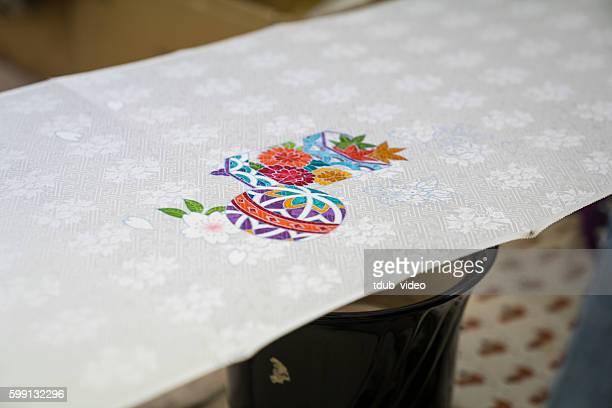 artisans paint designs onto raw kimono fabric in kyoto, japan - 染料 ストックフォトと画像