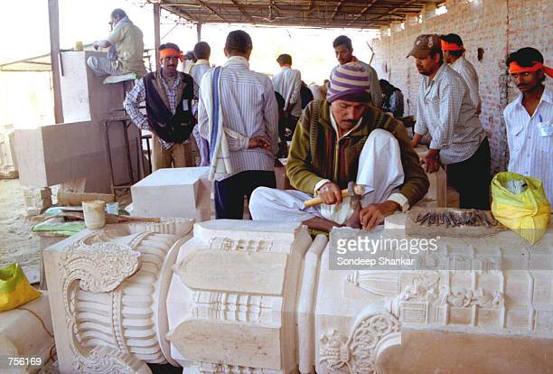 Artisans working on sandstone carve pillars for the Ram Temple March 5 2002 at Ayodhya India The construction of Ram Temple has caused communal riots...