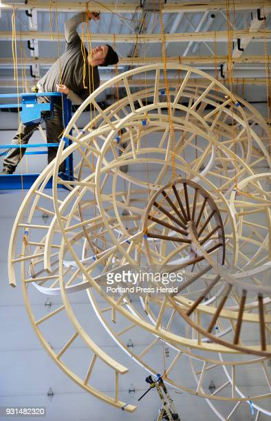 Artist Aaron T Stephan disassembles his wooden sculpture Paths Woven at his Portland studio Wednesday February 28 2018