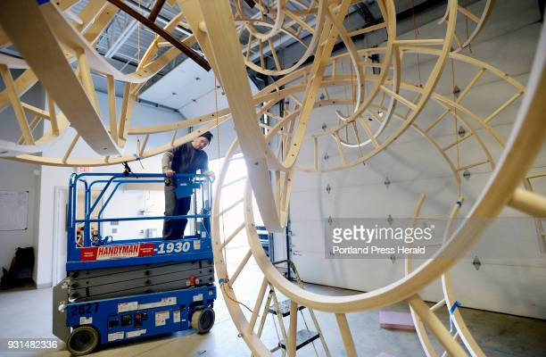Artist Aaron T Stephan uses a lift as he disassembles his wooden sculpture Paths Woven at his Portland studio Wednesday February 28 2018
