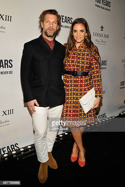Artist Aaron Young and fashion entrepreneur Laure Heriard Dubreuil attend Louis XIII Celebration of '100 Years' The Movie You Will Never See starring...