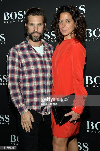Artist Aaron Young and guest attend HUGO BOSS celebrates Columbus Circle BOSS flagship opening featuring premiere of 'Anthropocene' by Marco...