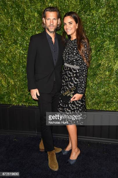 Artist Aaron Young and Laure Dubreuil attend the CHANEL Tribeca Film Festival Artists Dinner at Balthazar on April 24 2017 in New York City