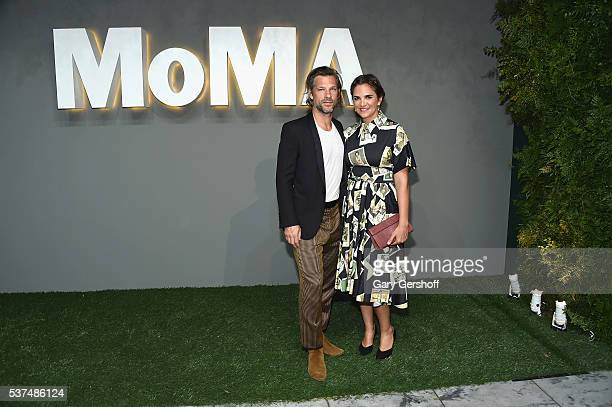 Artist Aaron Young and Laure HeriardDubreuil attend the 2016 Museum of Modern Art Party in the Garden at Museum of Modern Art on June 1 2016 in New...