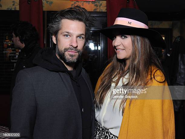 Artist Aaron Young and Laure HeriardDubrueil attend the Band Of Outsiders Fashion Week Mens Collection After Party held at the Monkey Bar on February...
