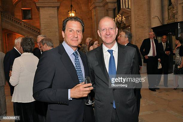 Artist Adam Bartos left and Robert P Morgenthau president and chief executive officer of NorthRoad Capital Management LLC attend a dinner at the New...