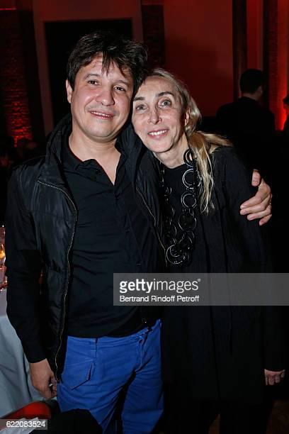 Artist Adel Abdessemed and Carla Sozzani attend the Carla Sozzani Photo Exhibition at Azzedine Alaia Gallery on November 9 2016 in Paris France