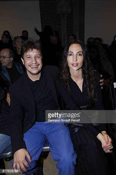 Artist Adel Abdessemed and his wife Julia Abdessemed attend the Azzedine Alaia Fashion Show at Azzedine Alaia Gallery on October 23 2016 in Paris...