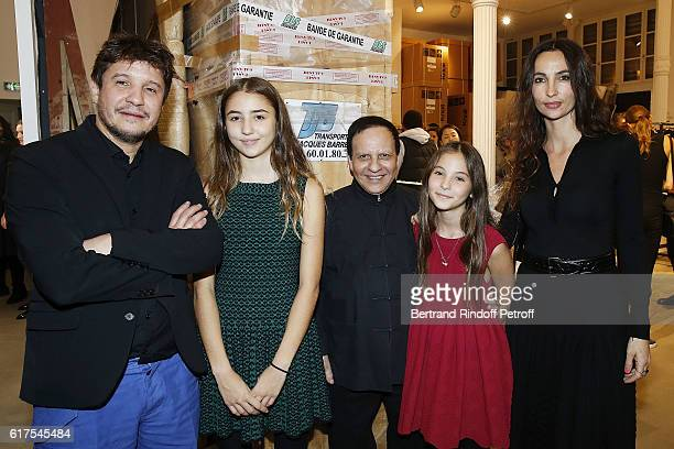Artist Adel Abdessemed his daugthers Ksu and Elle Azzedine Alaia and Julia Abdessemed attend the Azzedine Alaia Fashion Show at Azzedine Alaia...