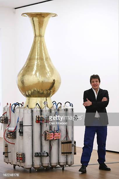 Artist Adel Abdessemed stands beside his sculpture entitled 'Le Vase abominable' 2013 at the David Zwirner Gallery on February 21 2013 in London...