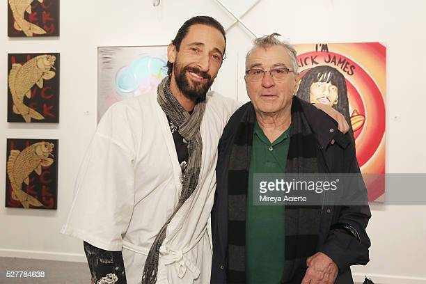 Artist Adrien Brody and actor Robert De Niro pose in front of Adrien Brody's artwork during the the kick off of Art New York and CONTEXT for 2016 New...