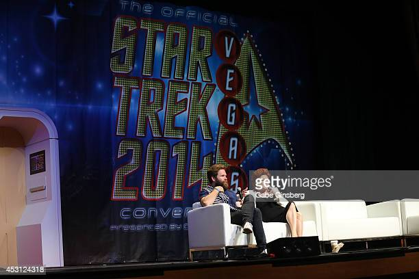 Artist Alec Egan and his mom actress Kate Mulgrew speak on stage during the 13th annual Star Trek convention at the Rio Hotel Casino on August 3 2014...