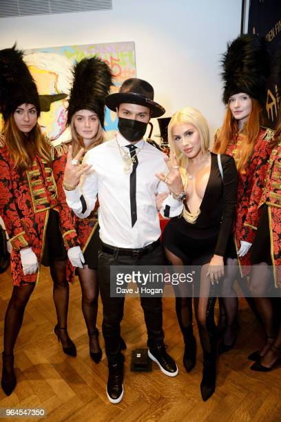 Artist Alec Monopoly and guest attend Alec Monopoly's 'Breaking the Bank on Bond Street' exhibition launch party at the Eden Fine Art Gallery on May...