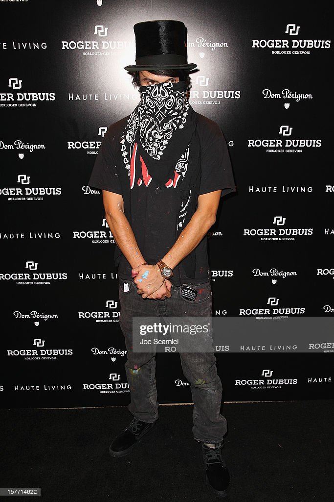 Artist Alec Monopoly attends the Haute Living and Roger Dubuis dinner hosted by Daphne Guinness at Azur on December 5, 2012 in Miami Beach, Florida.