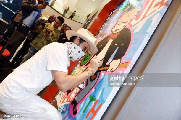 Artist Alec Monopoly paints during TAG Heuer Connected Watch V2 Popup Store Inauguration at Bhindi's on March 15 2017 in Glendale California