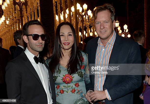 Artist Alex Israel Art Film Gala cochair and LACMA Trustee Eva Chow wearing Gucci and director Doug Aitken attend LACMA 2015 ArtFilm Gala Honoring...