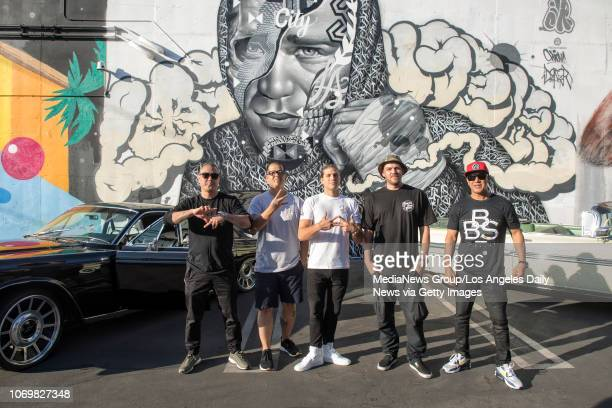 Artist Alex Kizu Richard Wyrgatsch II topranked UFC featherweight Brian Ortega artist Tristan Eaton and Ortega's coach James Luhrsen in front of a...