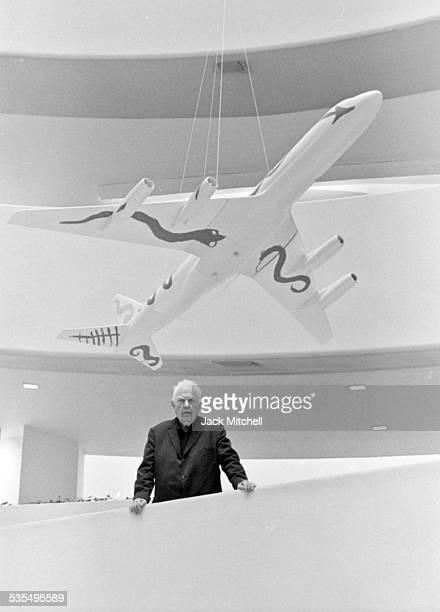Artist Alexander Calder and his painted jet airplane models at the Guggenheim Museum in August 1973