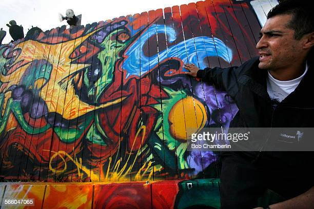Artist Alexander Garcia talks about the section of fence he re–painted to cover the word like which city inspectors said drew a complaint and led...