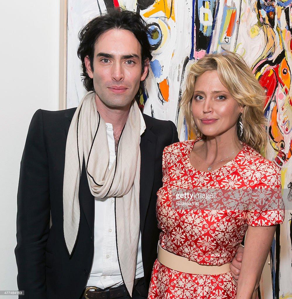 Artist Alexander Yulish (L) and actress Estella Warren attend Alexander Yulish 'An Unquiet Mind' VIP Opening Reception at KM Fine Arts LA Studio on March 8, 2014 in Los Angeles, California.