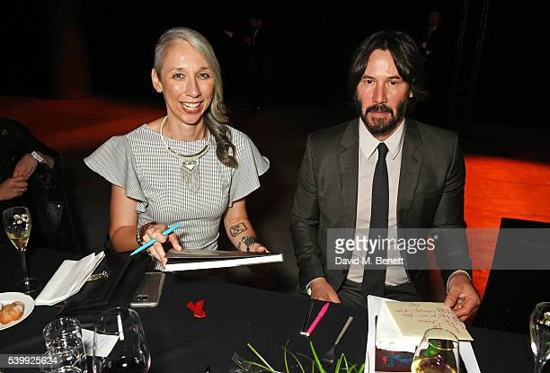 Artist Alexandra Grant and Keanu Reeves attend the UNAIDS Gala during Art Basel 2016 at Design Miami/ Basel on June 13 2016 in Basel Switzerland