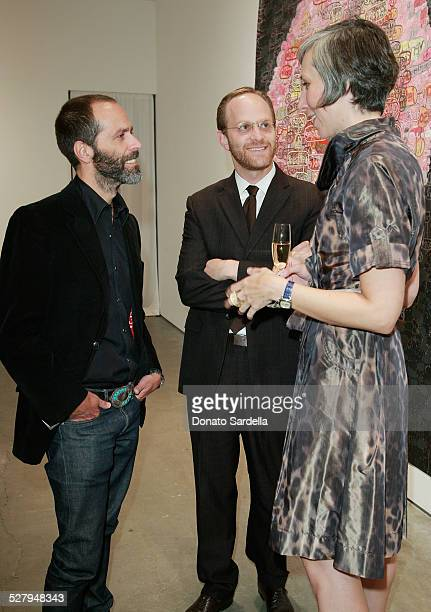 Artist Alexandra Grant chats with Roman Alonso and Ari Weisman at a dinner hosted by Vogue and Mulberry celebrating the work of Alexandra Grant on...