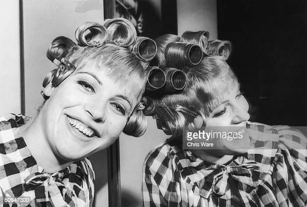 Artist and actress Pauline Boty with her hair in curlers before starring as 'the girl with the golden bra' in the Frank Hilton comedy 'Day of the...