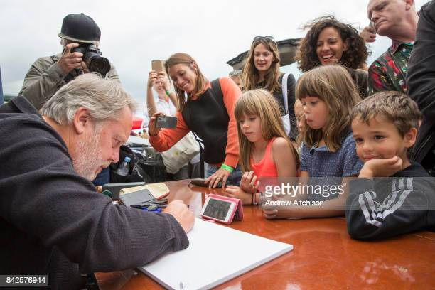 Artist and comedian Vic Reeves does live drawing for £100 of a musician to one of their tracks at the 2017 Art Car Boot Fair Folkestone Kent Here he...