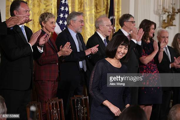 Artist and designer Maya Lin takes her seat on stage during a Presidential Medal of Freedom presentation ceremony at East Room of the White House...